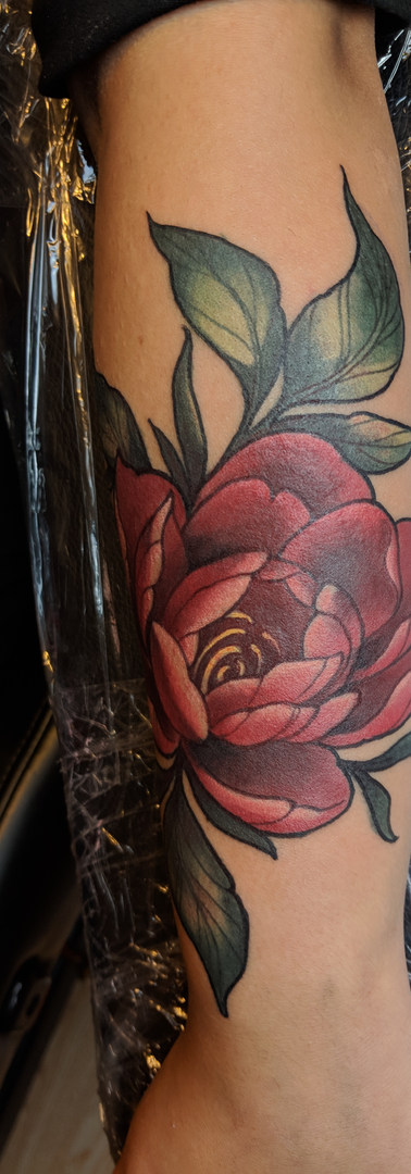 Illustrative Peony tattoo Detailed photo of fox calf tatto by Amy Porter