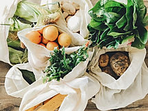 fresh vegetables in eco cotton bags on t