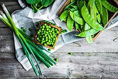 Green vegetables on wooden background.jp