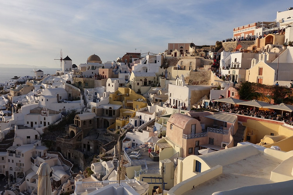 Santorini sunset over the beautiful painted buildings