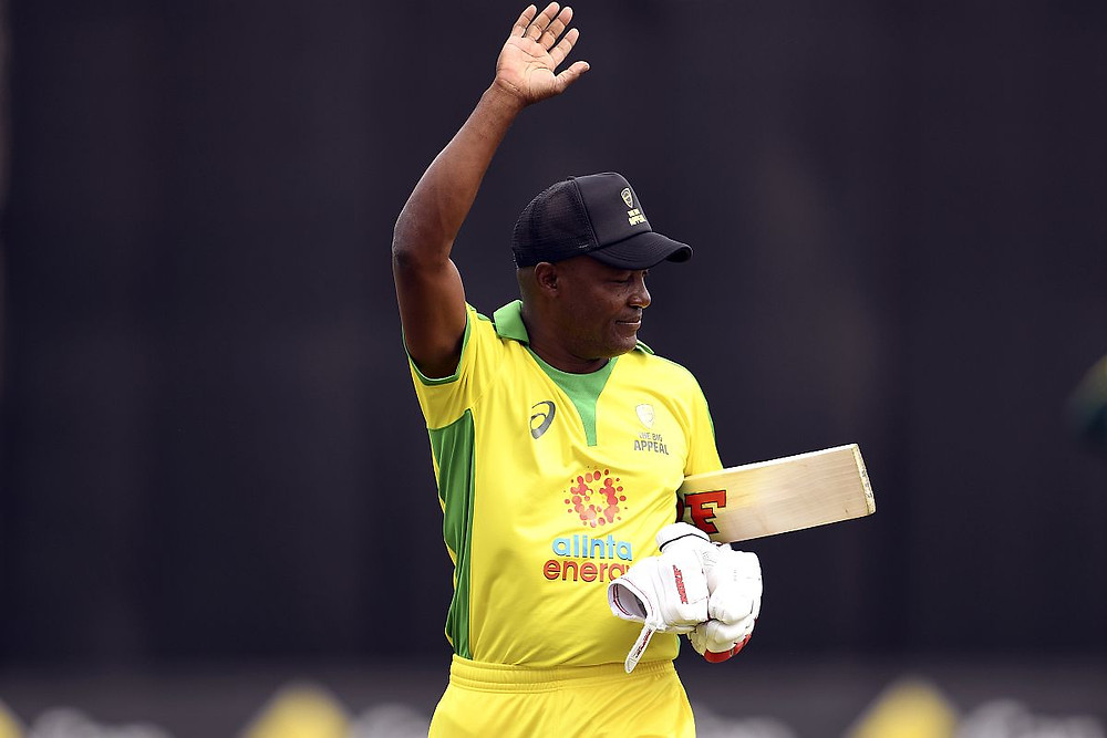 A wave from the legendary Brian Lara after his batting masterclass at the Bushfire Bash.