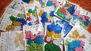 Adesivos em E.V.A. com glitter,papel adesivado glitterizado, em vinil e em couché.