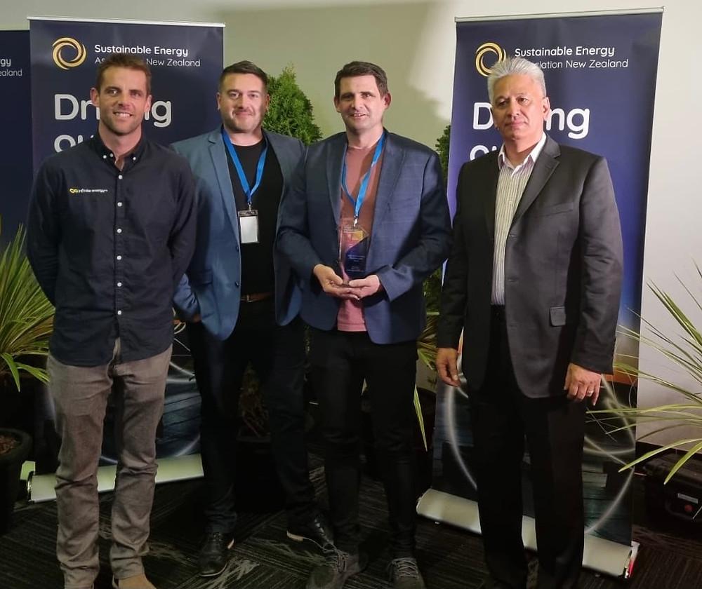 Craig, Regan and Mike accepting 2021 SEANZ award from Brendan