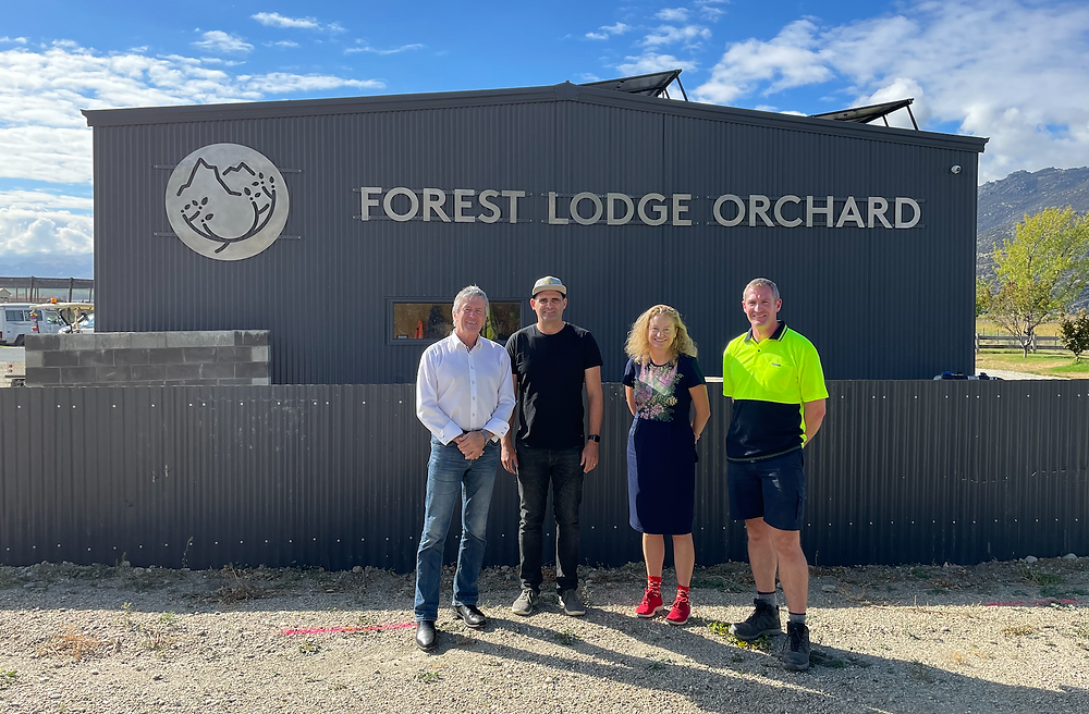 Damien Oconner, Mike Casey, Rachel Brooking and Euan White standing in front of Forest Lodge Orchard sign