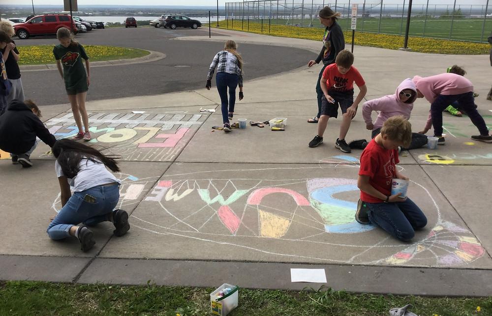Students create chalk art