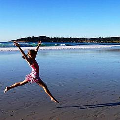 Girl dancing on Carmel Beach