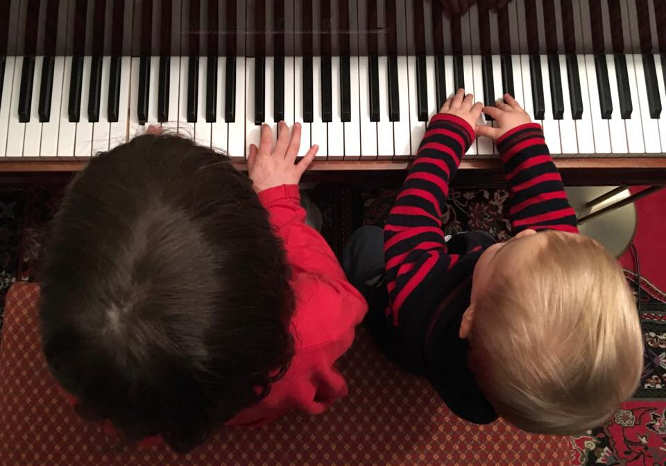 Nina and Leo playing piano
