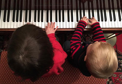 Nina and Leo playing piano