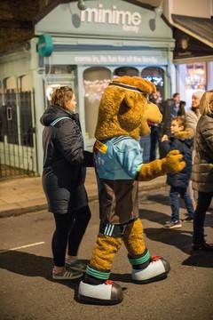 Harlequins mascot making acquaintances with the Teddingtonians