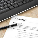 Closeup of Resume with Pen and Keyboard