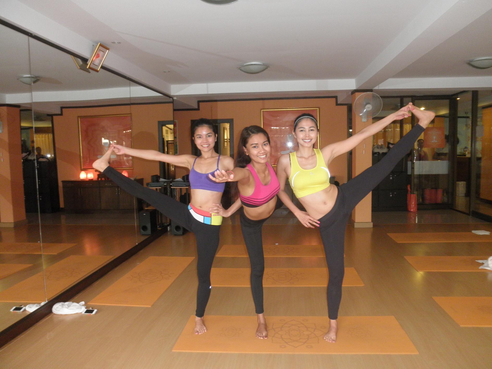 happy friends doing Yoga