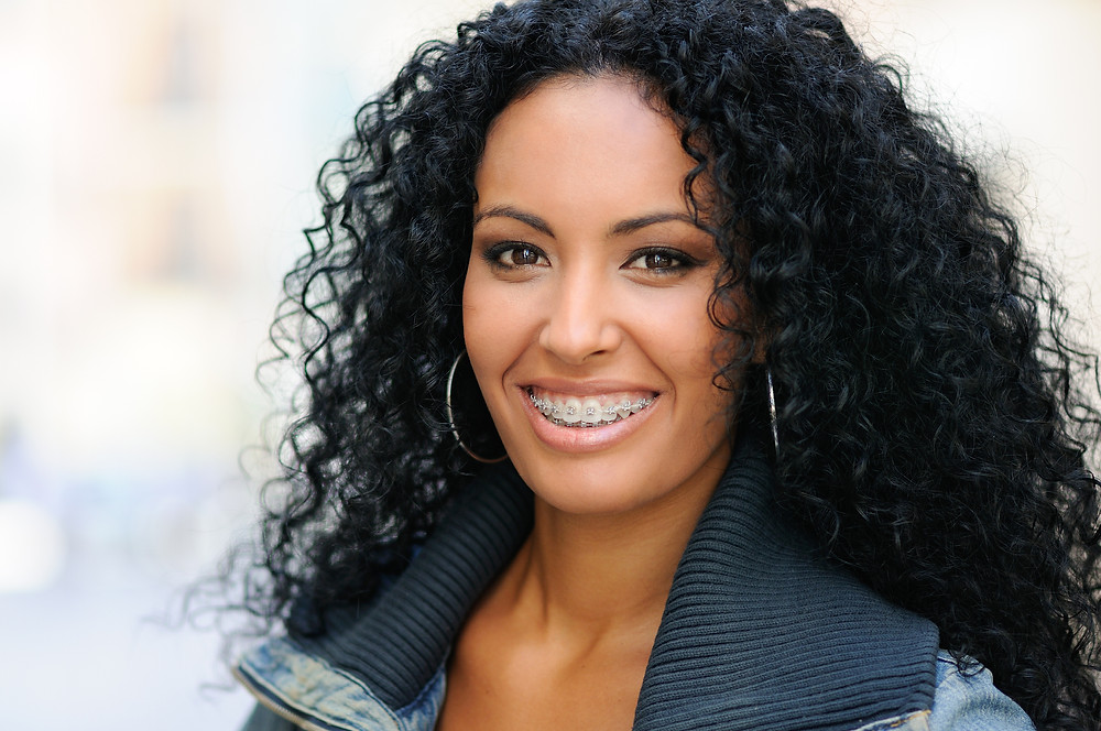Young Black Woman Smiling With Braces.jpg