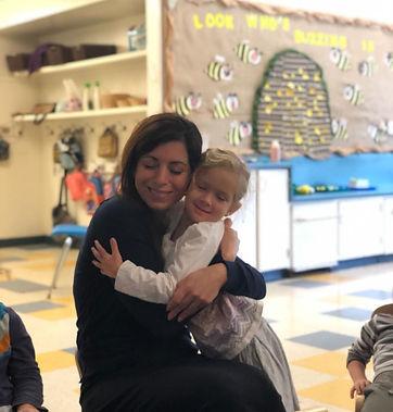 pic teacher hugging child.JPG