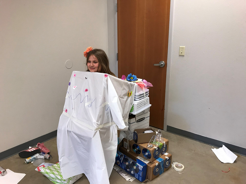 One student models her recycled costume