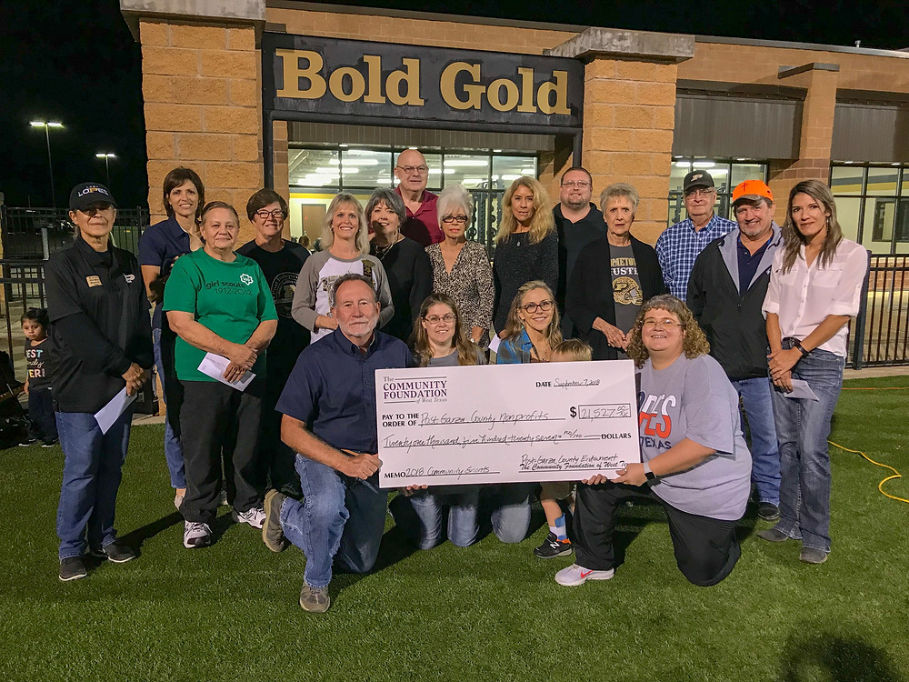 Group photo with large check