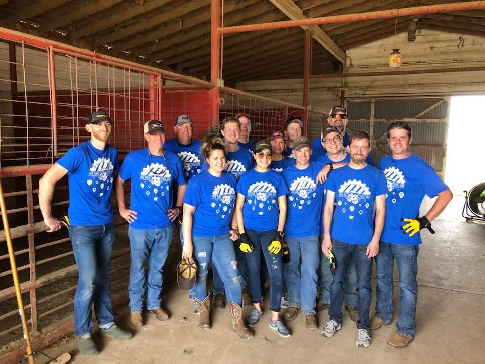 Volunteers cleaning stables