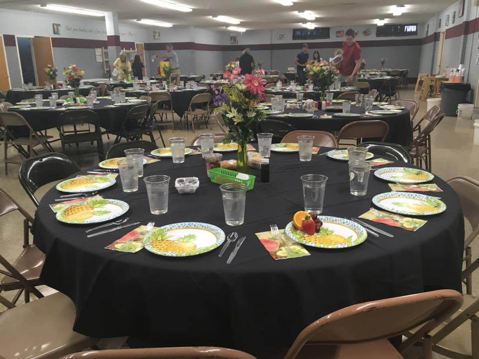 Tables set for a meal at Lubbock Impact