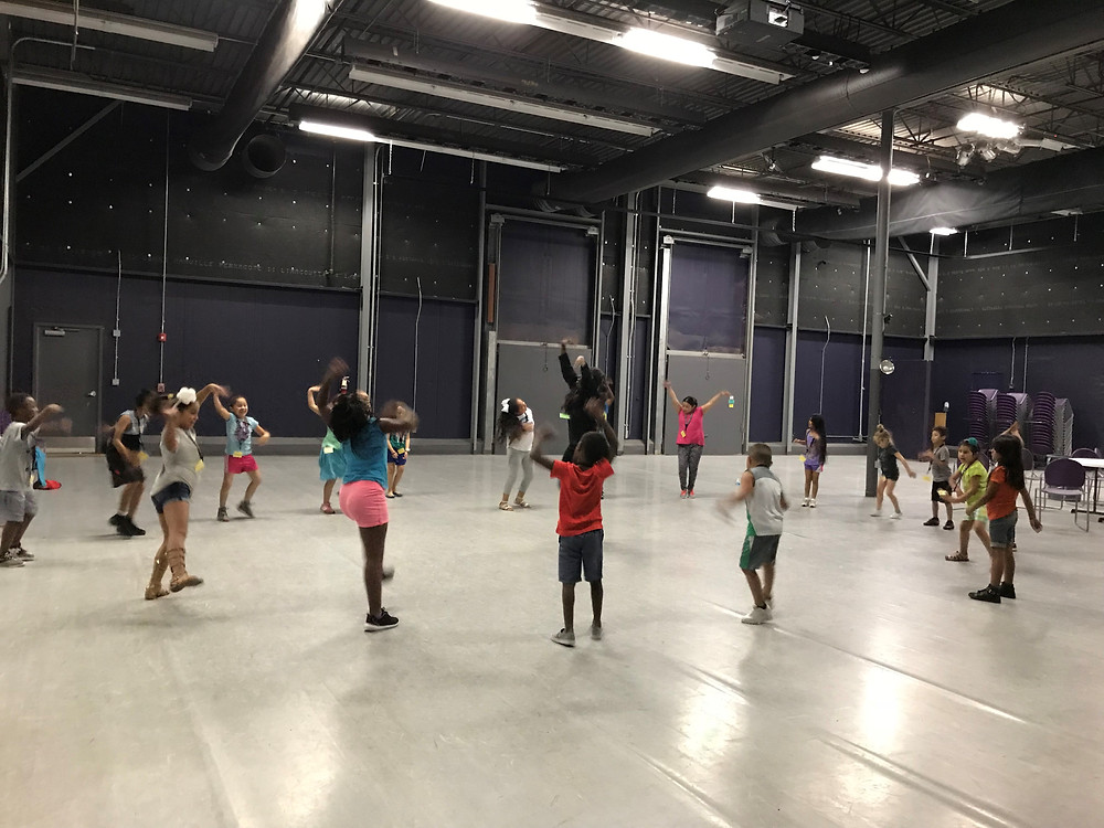 Students warm up for dance class