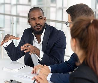 black millennial holding the floor in boardroom_edited.jpg