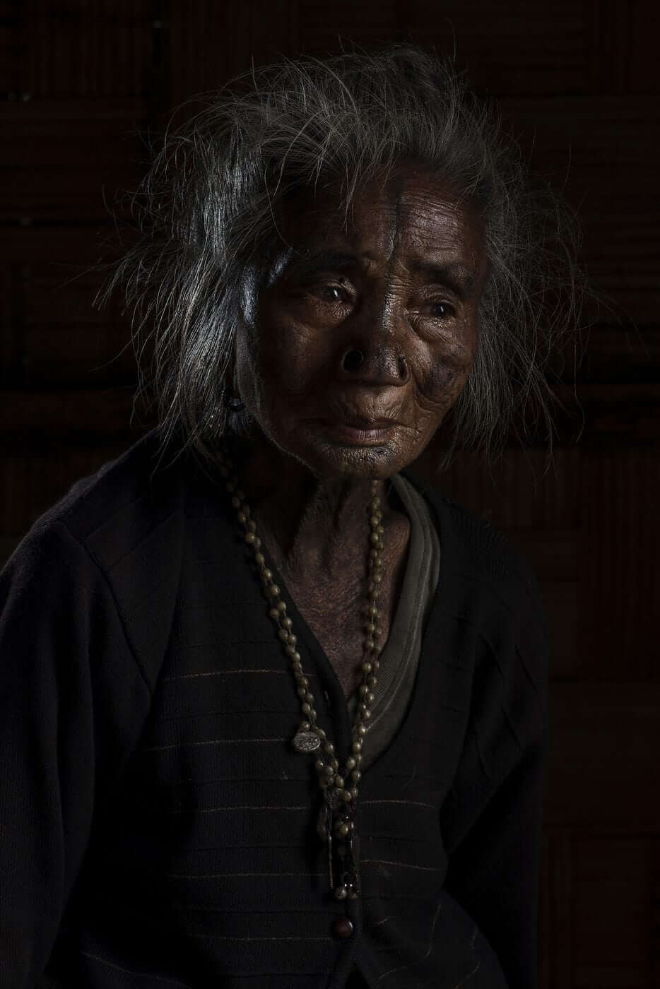 """Kago Yapii, 70's When Yapii was five or six she had her modifications done. She says, """"I really wanted to have this done and I had no fear at all"""""""