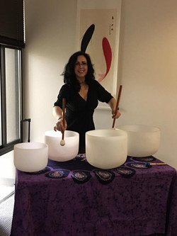 Playing Crystal Bowls at Many Rivers Acupuncture 1
