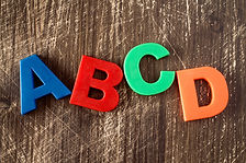 ABCD spelling from plastic letters on w