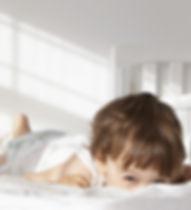 Toddler Peeking Over Bed Quilt2