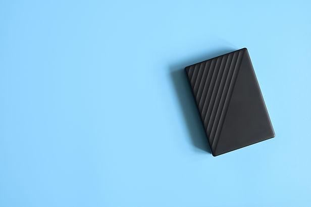 external-hard-drive-black-color-on-blue-