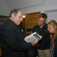 Israeli Supreme Court Justice and former Chief of Staff to Foreign Minister Moshe Dayan Elyakim Rubinstein (L) shares a photo from his book with Director Harry Hunkele (M) and film Publicist Vered Kollek (R).