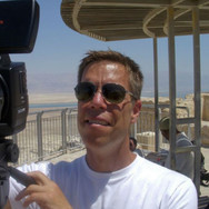 Director, Harry Hunkele reviews the framing of footage being shot, overlooking the Dead Sea.