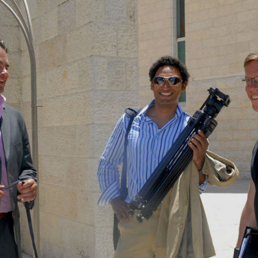 Executive Producers Arick Wierson (L) and Matthew Tollin (M) share a laugh between shoots with Director Harry Hunkele ®
