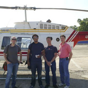 Executive Producer Matthew Tollin and Director Harry Hunkele, before lift-off for aerial footage shoot from chopper with local Israeli journalists.