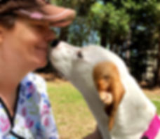 Woman and dog nose to nose