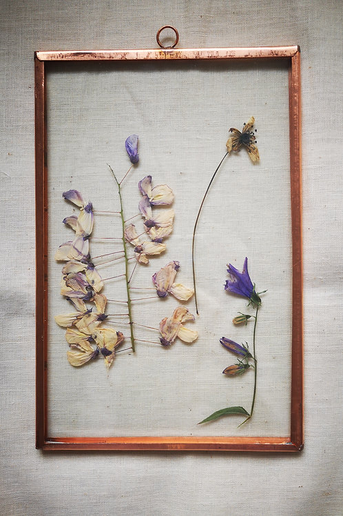 Copper frame with purple flowers