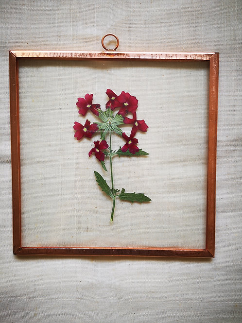 Copper frame with red flowers