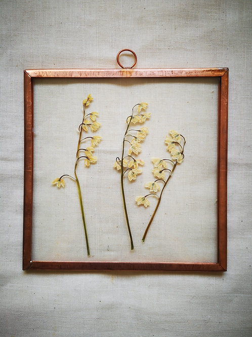 Copper frame with white flowers