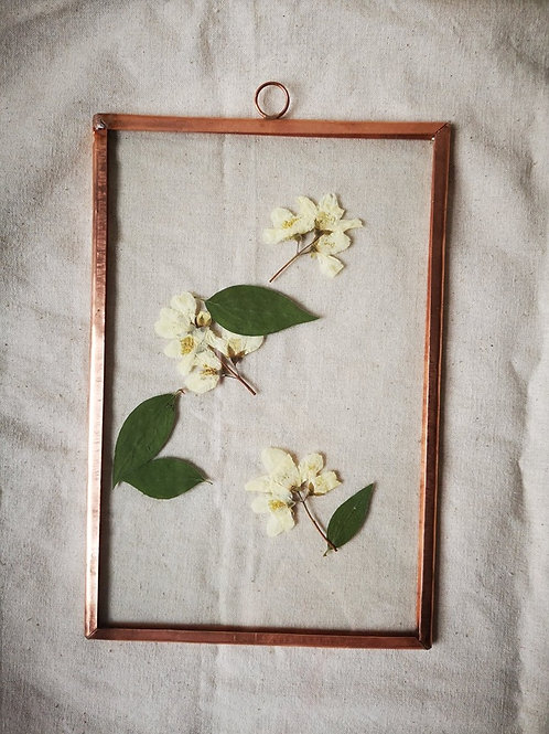Copper frame with white flowers and leaves