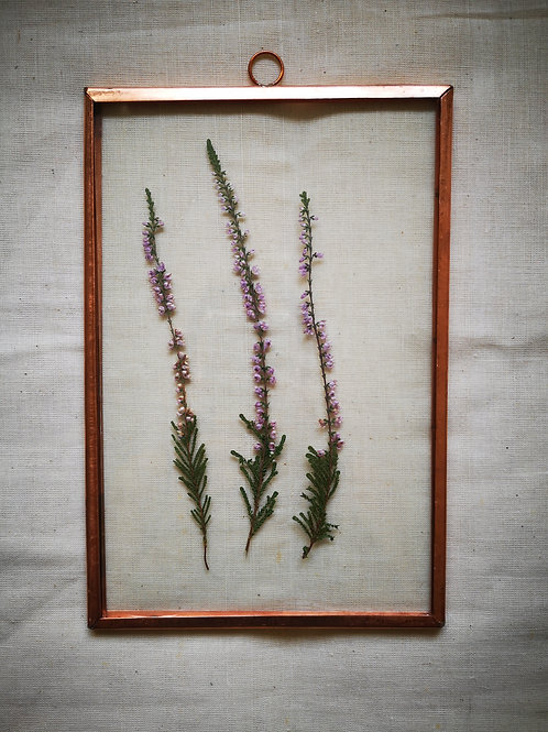 Copper frame with long purple flowers