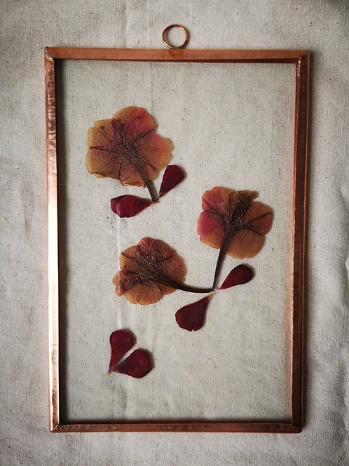 Copper frame with red and brown flowers