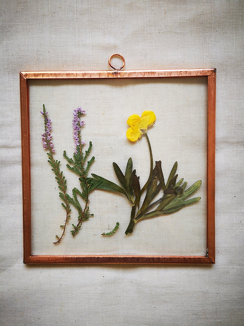 Copper frame with yellow & purple flowers