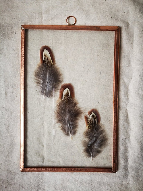 Copper frame with feathers