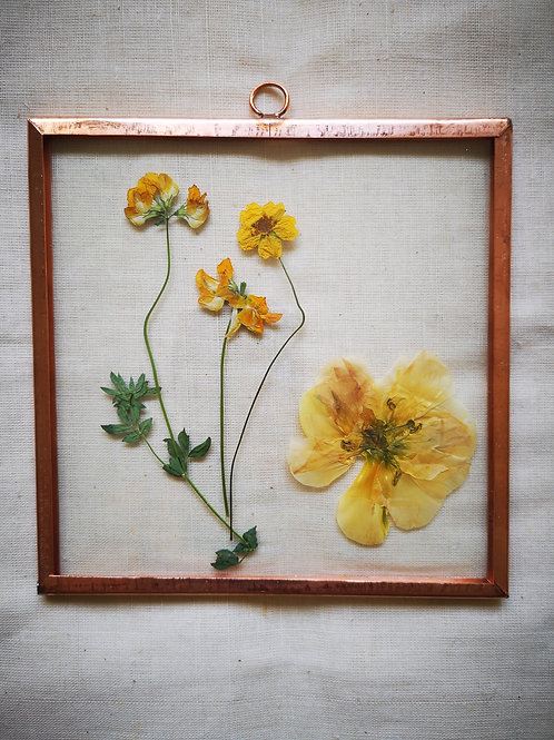 Handmade botanical frame with mix of yellow flowers
