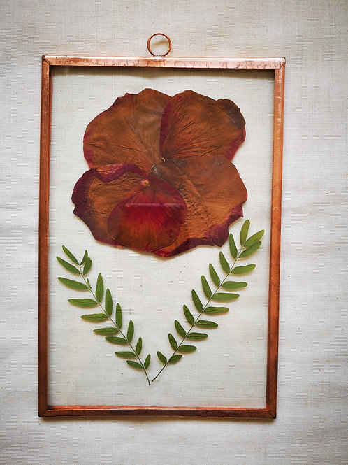 Copper frame with red flower