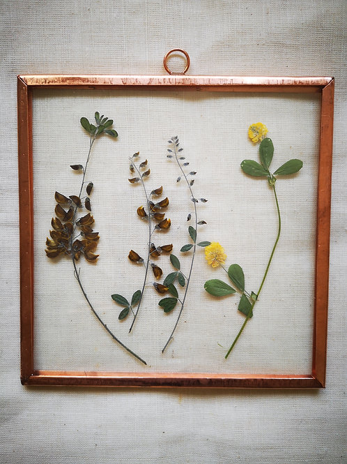 Copper frame with mix of yellow & brown flowers