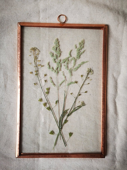 Copper frame with grass and little white flowers