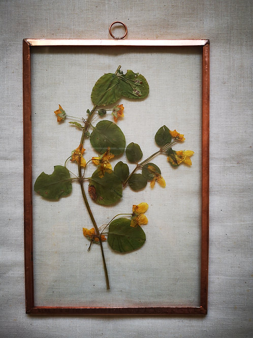 Copper frame with yellow flowers