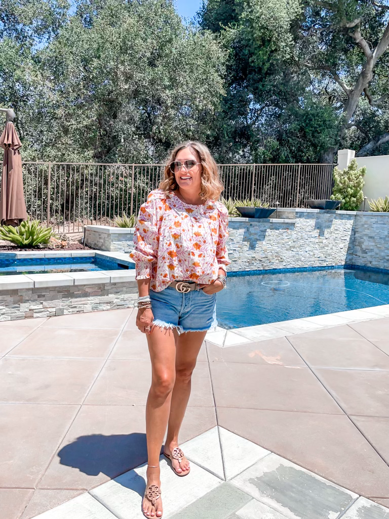 how to style denim shorts. Tory Burch Miller sandals. floral top. Gucci belt. how to style a Gucci belt.