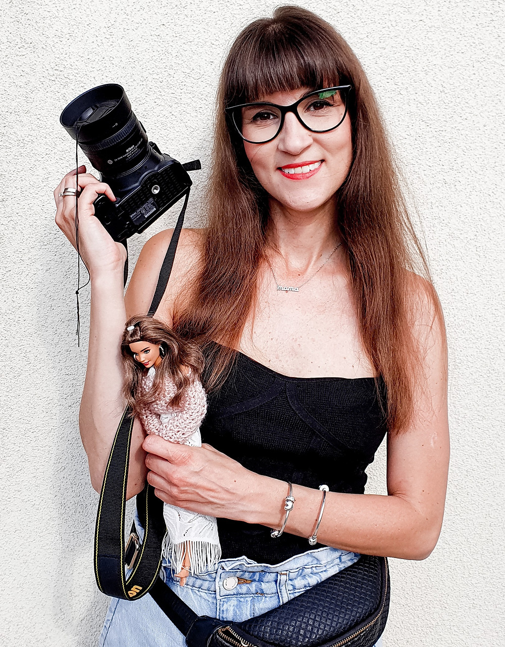 Doll Photographer Izabela Kwella with her camera and 12 inch fashion barbie doll toy