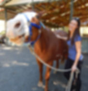 An image of Carolyn and a horse.