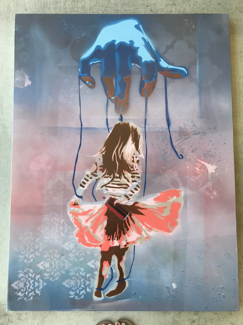 3 by 4 foot spray painted canvas. I created a gradient for the background and added smaller stencils. I tore the paint off in places with saran warp to add texture.  I created and cut my own stencils for the hand and the girl.